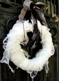 Use a wreath form from the craft store, then wrap spooky cheese cloth around for an easy, eerie Halloween decoration http://lmandbc.com/