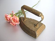 Vintage Iron Sad Iron Cast Iron Doorstop Paperweight by Swede13. $24.00 USD, via Etsy.