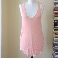 Free People tank Melon-colored Free People tank. Super soft with straps at the shoulders. Front hem is cut longer, perfect for a front tuck. Never worn. Size S. Free People Tops Tank Tops