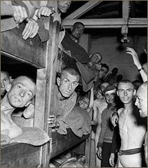 Emaciated prisoners at Mauthausen welcome their liberators, the 11th Armored Division, May 6,1945.