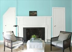 Look at the paint colour combination I created with Benjamin Moore. Via @Benjamin_Moore. Wall: San Clemente Teal 730; Door & Mantle: Chantilly Lace OC-65.