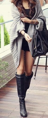 Woolen cardigan with long boots and mini skirt