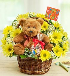 "Lotsa Love® Happy Birthday   Price:  US$49.99  Turn their birthday into the biggest smile-fest of the year! Send our signature Lotsa Love® birthday surprise, featuring enough gifts to keep them happy until next year. Our adorable plush brown bear leads the way, paired with a vibrant fresh basket arrangement, a bag of sweet treats and a festive ""Happy Birthday"" felt pick."