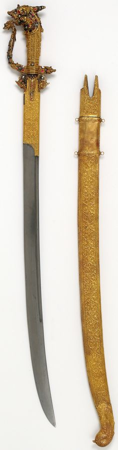 Sword and sheath (kastane) with a dragon-headed pommel Steel, chased and embossed gold sheath Travancore, Kerala, India 19th century Museum nos. 2573:1,2(IS)  The kastane is the national sword of Sri Lanka. It typically has a short curved single-edged blade, double-edged at the point. The hilt comprises a knuckle-guard and down-turned quillons, each terminating in a dragon's head.