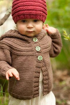 Knit child's beanie hat and hooded cardigan sweater