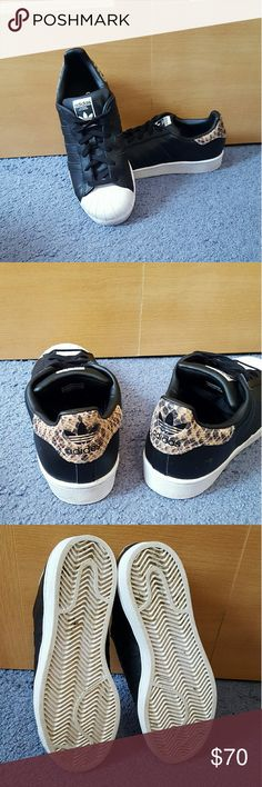Womens Adidas black and cheetah superstars Has been worn Worn less than 5 times Size 8 Run a little big Superstars Cheetah print back No Trades Adidas Shoes Sneakers