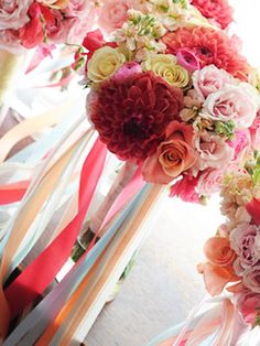 Ribbon hanging anywhere (chairs, ceilings, tables) is hot right now. Add some colorful strands to your bouquet wrap for a whimsical touch your guests won't expect.