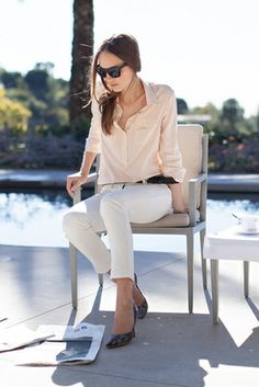 neutrals: white jeans, blush silk blouse, black accessories | Emerson Fry