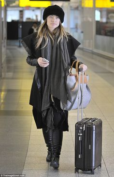 Working woman! Olivia Wilde, 31,caught a flight out of JFK on Thursday after a busy promotional trail in New York City