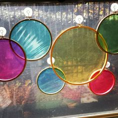 """Color garden"" for toddler classroom. Colored cellophane in embroidery hoops, can be hung overlapping to show color mixing"
