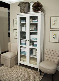 IKea Hemnes dressed with wallpaper, glass doors. Teal colors. Linen closet.