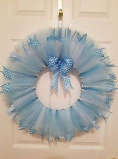 Blue tulle wreath Nursery decor Nursery wall by WreathsbyGramGender Reveal Party Gender Reveal Decor Baby by WreathsbyGramThis beautiful wreath is perfect for any baby shower, gender reveal or nursery! It is made of tulle in varying shades of shimmer Gender Reveal Decorations, Baby Shower Decorations For Boys, Idee Baby Shower, Baby Shower Parties, Boy Shower, Tutu Wreath, Expecting Mom Gifts, Nursery Wall Decor, Nursery Ideas