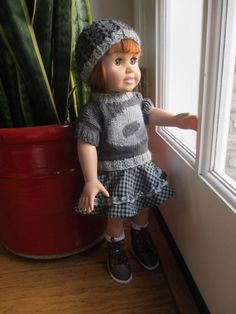 Hand knitted hat and a sweater for 18 inch doll. The skirt and the boots are from Kidz 'n cats doll