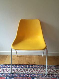 Yellow Robin Day Plastic moulded chair