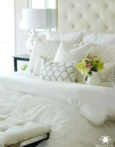 Five Times to Go White in Your Home- Cloud like master bed inspiration with Pottery Barn Lorraine tufted headboard and white Hadley Ruched Duvet bedding
