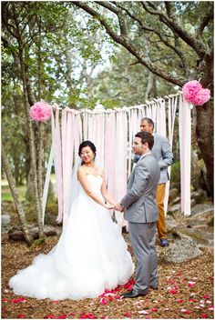 woodland wedding ceremony with pastel pink decorations and backdrop  | Photography © Caught the Light via French Wedding Style