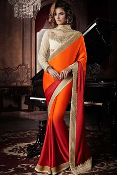 Maroon Orange Georgette Satin Saree with Net Blouse Prix:-94,61 € Designer Saree Collection now in store presented by Andaaz Fashion like Maroon Orange Georgette Satin Saree with Net Blouse. The dress is embellished with Embroidered, Zari, Round Neck Blouse, Full Sleeve, and with Designer Pallu. This dress is prefect for Party, Wedding, Festival, Ceremonial http://www.andaazfashion.fr/maroon-orange-georgette-satin-saree-with-net-blouse-dmv7710.html