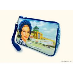 """The """"We All Have Our Luggage"""" cosmetics bag is a matte vinyl bag featuring the vintage inspired art of Anne Taintor of an airline traveler in front of a TWA DC-3.  The bag measures approximately 7.5""""x 5""""x 2.5"""" and comes with a removable strap."""