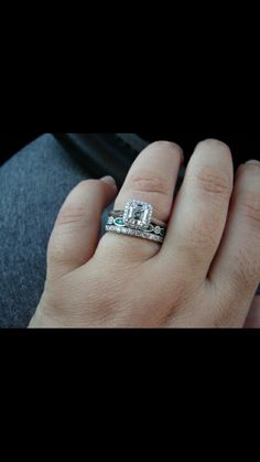 My diamond is much more simple and my wedding band will be a much bigger carat weight but this is the general idea of what I'm going for. I love the emerald band in between the 2