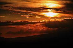 雲を染める夕日