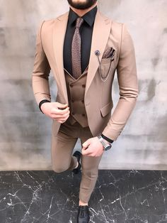 Collection: Spring – Summer 2020  Product: Slim-Fit Suit  Color Code: Brown  Size: 42-44-46-48-50-52  Material: 80% Wool, 20% Viscose  Machine Washable: No   Fitting: Slim-fit  Cutting: Double Slits, Single Button  Package Include: Jacket, Vest, Pants, Tie and Chain Only  Dry Clean Only