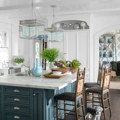 Farrow & Ball's Down Pipe on the island cabinetry grounds the otherwise all-white kitchen in a Greenwich, Connecticut, house.