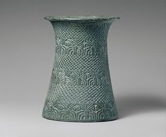 """Vase with overlapping pattern and three bands of palm trees Vessels carved of a gray-green stone in what is called the """"Intercultural Style"""" were made in the greater Gulf area as well as in southern Iran. At the site of Tepe Yahya in Iran,"""