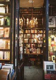 """Librairie Ancienne et Moderne, Galerie Vivienne, Paris (by shevyvision:) """"Walking the stacks in a library, dragging your fingers across the spines — it's hard not to feel the presence of sleeping spirits."""" Robin Sloan"""