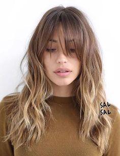 Wavy balayage hairstyles with bangs blonde light brown hair