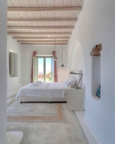 Whitewashed Tuscan style bedroom