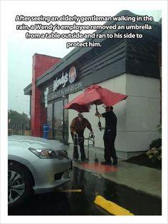 Wendy's employee helping an elderly gentleman
