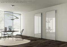 Porte scorrevoli ARIA mod. BASIC 42 con telaio in alluminio anodizzato naturale e vetro 3+3 laccato grigio coprente listo 2 lati. By ZEMMA