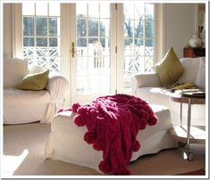 Love the Pom pom throw...click and follow how this DIY-er did it herself!  And NO, it's not just because it's pink!!!