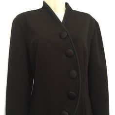 "10/26 HP  Black Knit Tulip Jacket  Work Week Chic HP by @hsohailk     This vintage knit jacket, features satin detail on center front, hemline and sleeve hems. This five button jacket has satin self covered buttons, front darts and back darts for shaping. This jacket is in excellent condition.  Machine washable.   Made in the USA.  40"" Bust 37"" overall length Jackets & Coats Blazers"