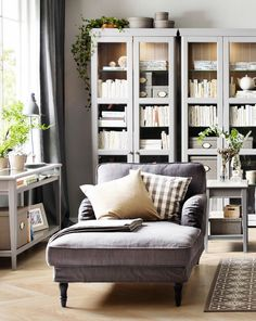 I like this chaise lounge from ikea! /// decorating with glass display cabinets / sfgirlbybay