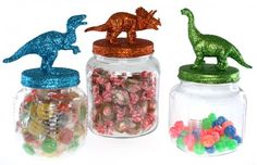 Glittered DinosaurJars - a fun and inexpensive way to organize small craft supplies, toys, or knick knacks!  #glitter #upcycle