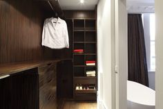 Walk in Wardrobe in Macassar Ebony by Inhouse Interiors