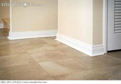 White baseboard along ceramic tile floor
