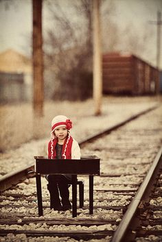 Piano trax.  Soooo many questions about this.  Why is the girl on the tracks with the piano?  Is the train going to run her over? Did she not have her lesson material ready?  Is someone going to save her?.....................