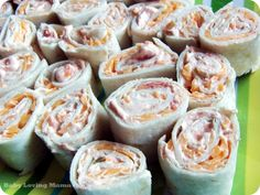 Kraft Salsa Roll Ups  ◦4 oz (1/2 of 8 oz pkg) Philadelphia cream cheese (or Neufchatel), softened ◦3 tablespoons thick and chunky salsa ◦4 flour tortillas (6 inch)  ◦1/2 cup Kraft Mexican Style Finely Shredded Four Cheese (or your favorite shredded cheese) ◦1/4 tsp chili powder (optional)