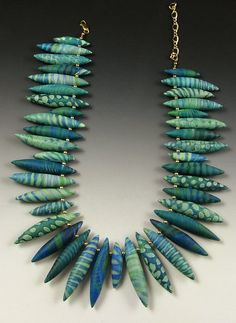 Green Fringe by JudyDunnPC, via Flickr - have never seen paper beads strung this way... really cool.