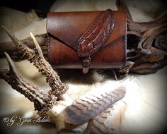 Belt pouch with feather motif