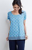 like the print and the neckline- unless it's too wide on my shoulders and shows my brastrap. I don't like the stiff material. Kind of looks like a maternity top.