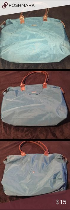 Travel Bag Nice spacious, packable turquoise travel bag. Zipper, and handles are intact. Small stain on the front. The pics really don't show the bags true color. I took the w/and without the flash. Delsey Bags Travel Bags