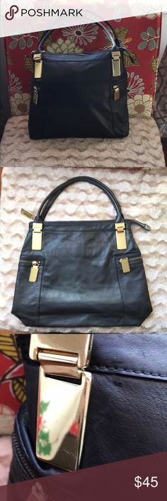 "Gorgeous Like New Leather Banana Republic Bag! This black and gold leather Banana Republic Bag is GORGEOUS! 100% genuine cow leather! It's very soft! The inside has one zipper pocket and two other pockets for organization. The outside has two zipper pockets on the sides with gorgeous gold zipper pulls! It's in EXCELLENT condition! It's 13.5"" in length it's 15.5"" wide and 14"" deep. The strap drop is 7.5"" Banana Republic Bags"