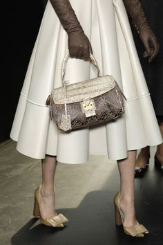 Louis Vuitton. Love the skirt!!!! & of course, the Bag & the Shoes!!