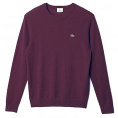 Lacoste plain crew neck fine knitted jumper with the Lacoste crocodile logo on the chest made in a figure hugging fit. Made from 100% Pure Wool.