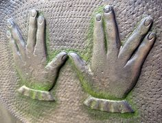 """Some Jewish tombstones display 2 hands arranged for the priestly blessing. Priests (Kohanim) are assumed to be descendants of Aaron, brother of Moses and the first Kohen.  And, yes, this symbol is like the Vulcan hand greeting (""""live long & prosper""""),  suggested by Leonard Nimoy (Mr. Spock), who saw the blessing in  synagogue as a child. He modified it, as Vulcans use only 1 hand."""