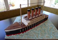 "Titanic Cake - Nothing quite says ""Happy Birthday"" like the Titanic. What can I say? My son is obsessed with the infamous boat. Everything is edible except the rail, mast and smoke stacks. The smoke stacks were made from PVC and we later filled them with dry ice so they smoked. It was a big hit with the 9 year old boy group!"