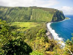 This beach in Waipio Valley is one of the hardest to get to in Hawaii—you must hike or drive down a treacherously narrow, steep road to reach your destination. But it's well worth the trek: At the bottom, you're rewarded with a mile-long black volcanic sand beach bordered by 2,000-foot cliff walls and backed by thick rainforest. If that weren't scenic enough, the Kaluahine and Waiulili waterfalls cut into the cliffs at the south end of the beach, and are accessible via a boulder-strewn trail…